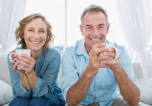 Middle aged couple who are confident about their oral health because of the restorative dentistry services they received at Legacy Dental in Omaha, NE.